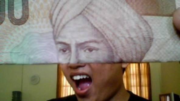 Uang 5000 sebagai pecahan yang harus disimpan