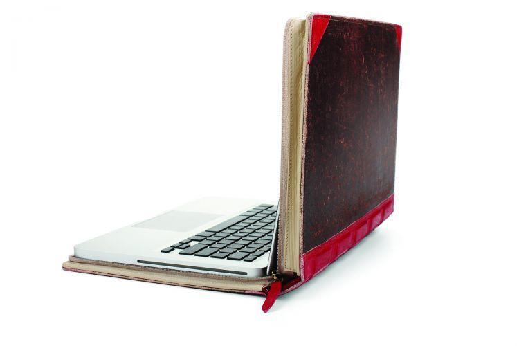 Softcase laptop dengan desain buku tua
