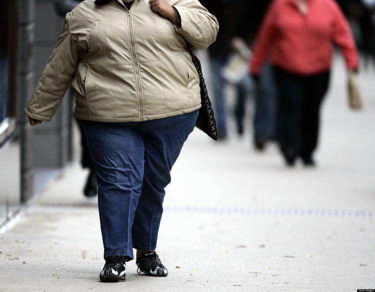 A women walks down the street on Michiga