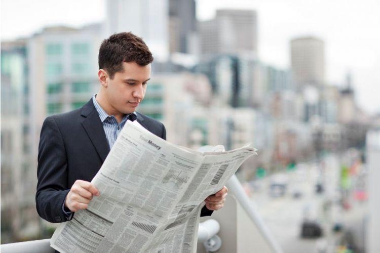 baca surat kabar