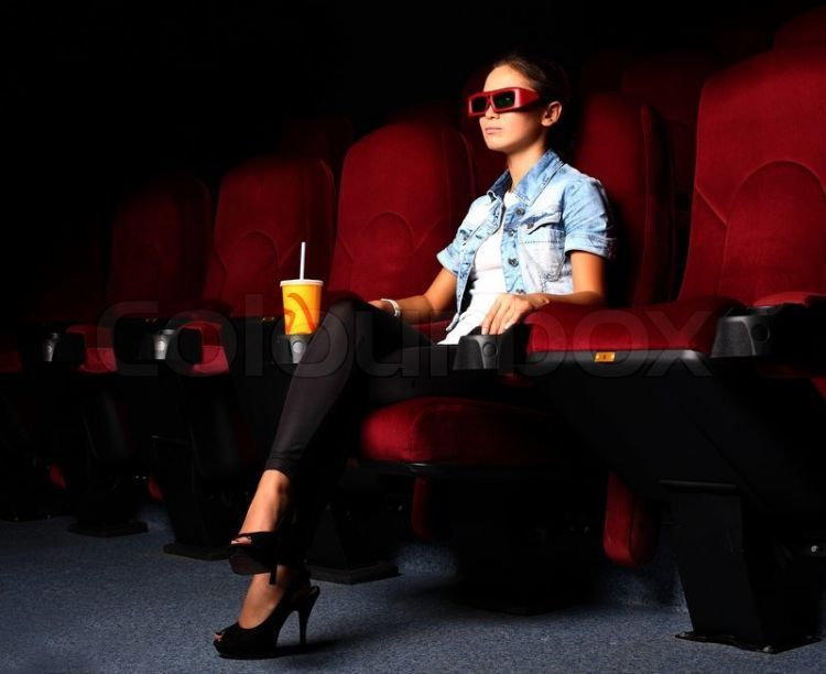 2396784-one-young-girl-watching-movie-in-cinema