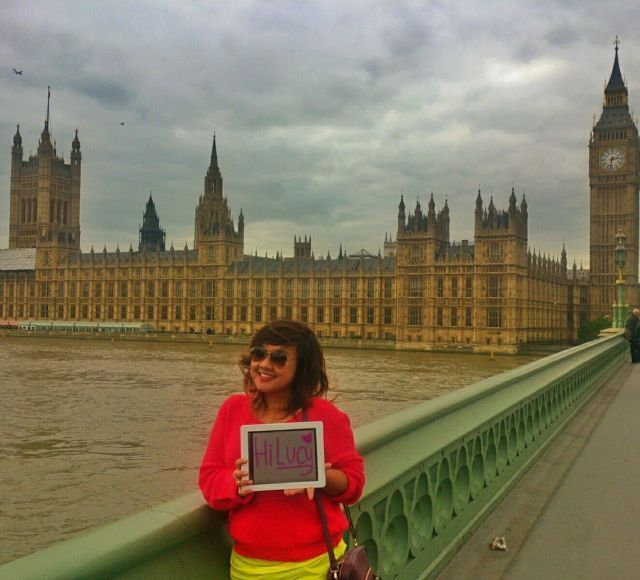 She's in front of Big Ben!