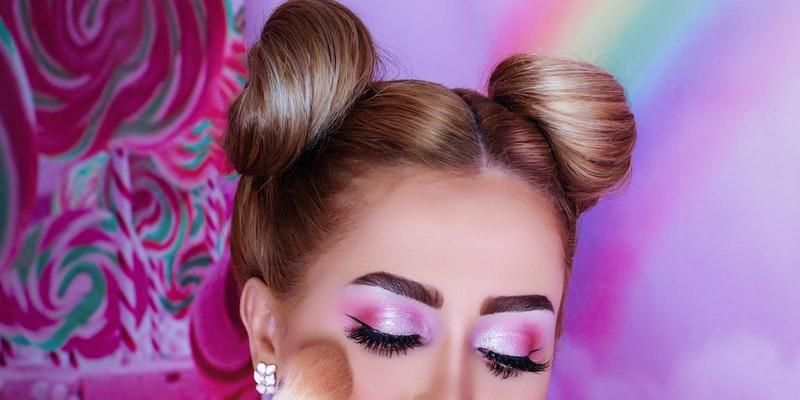 Women applying makeup on her face