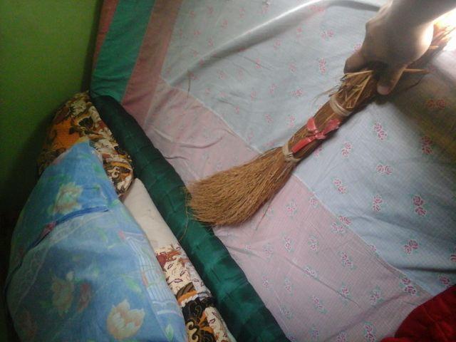 Oman untuk membersihkan tempat tidur