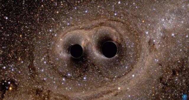 tumbukan dua blackhole yang menciptakan gelombang gravitasi