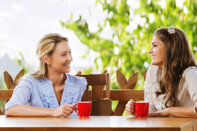 Two friends chatting with coffee