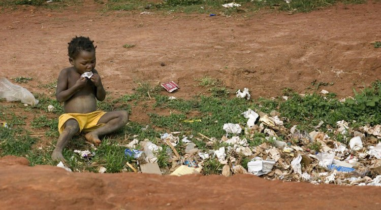 A child scavenges for food in a garbage pit near Malanje, Angola. United Methodist bishops in Africa have issued a Sept. 11 letter outlining new actions to combat poverty on the continent. The bishops that make up the church's African College of Bishops expressed