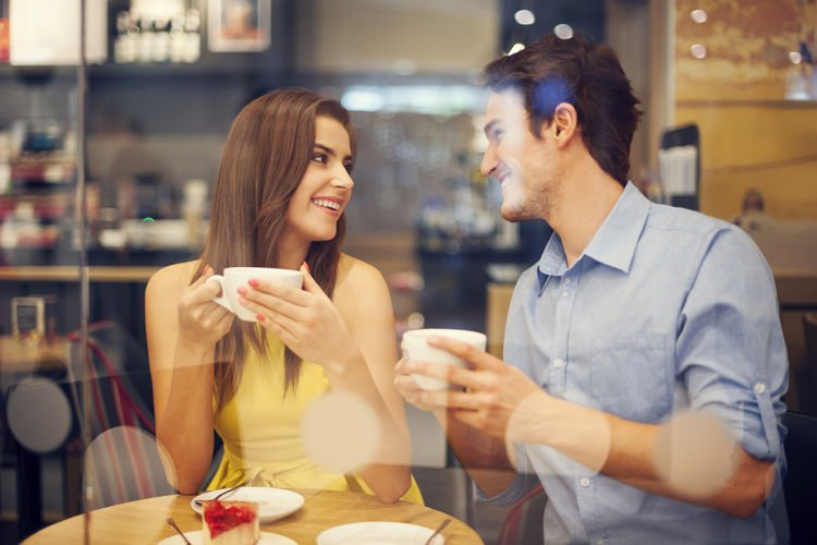 Two people in cafe enjoying the time spending with each other
