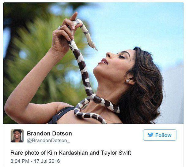 Kim lagi megang Taylor via kapanlagi.com