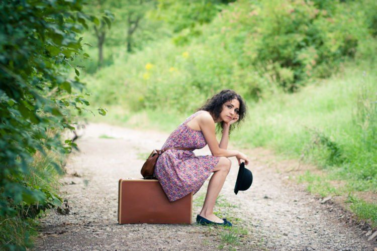 stock-woman-waiting-road-patience-9n3x