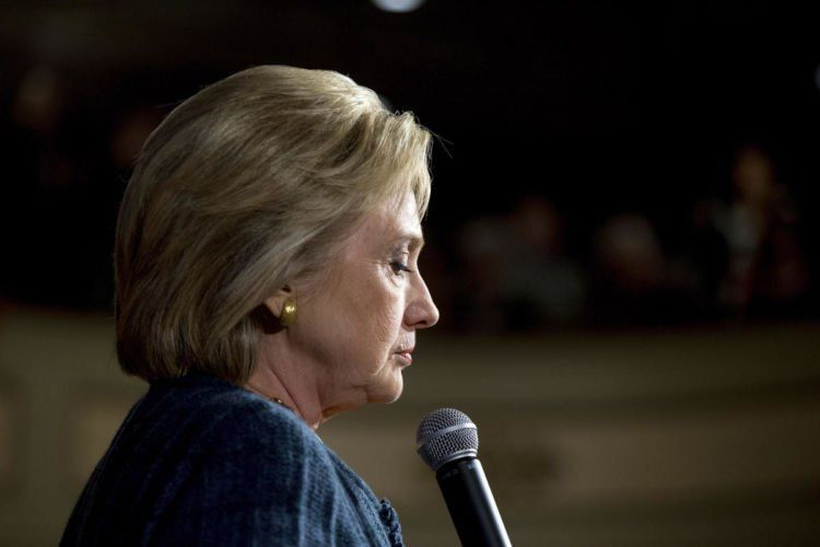 Democratic presidential candidate Hillary Clinton pauses while speaking at a rally at the Steyer Opera House at Hotel Winneshiek in Decorah, Iowa, Tuesday, Jan. 26, 2016. (AP Photo/Andrew Harnik)
