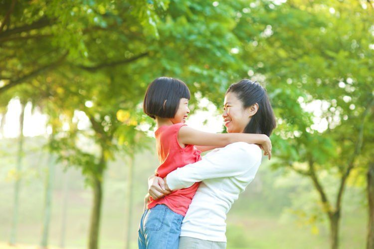 bigstock-asian-mother-hugging-her-daugh-36498718