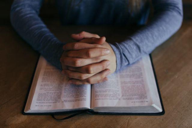 bible-hands-prayer-spraying