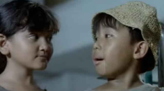 Joshua Suherman dan Mega Utami dalam film Joshua Oh Joshua.