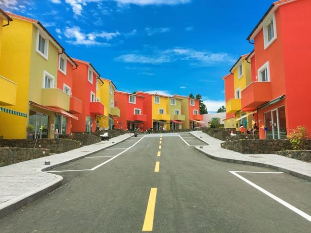 Brightly colored houses road