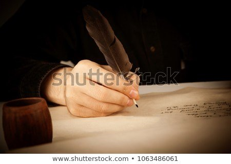 Writer Holds Fountain Pen Over Writing
