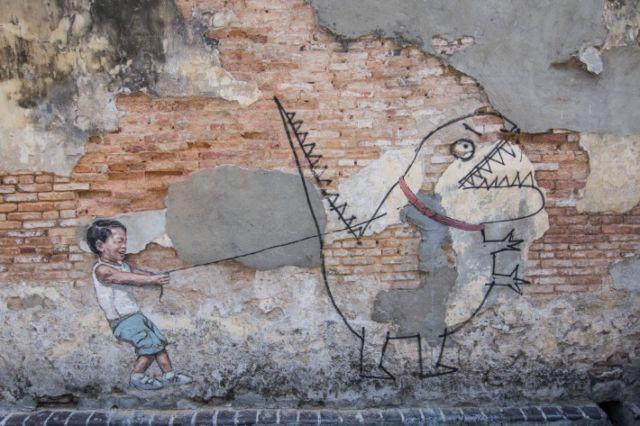 Little Boy with Pet Dinosaurus