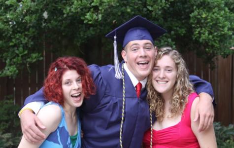 Siblings Graduation Hug