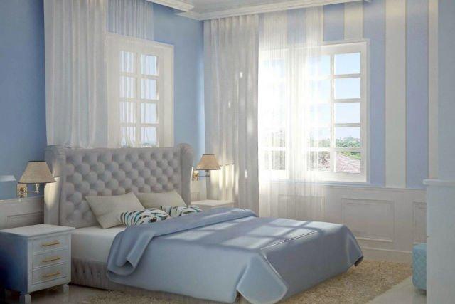 Desain interior warna biru Jayapura Residence di Papua karya Ruang Komunal