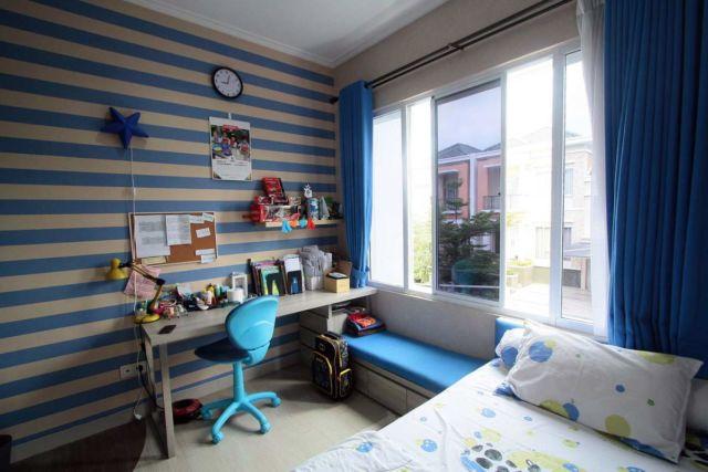 Desain interior warna biru Grand Galaxy Residence di Bekasi karya Exxo Interior