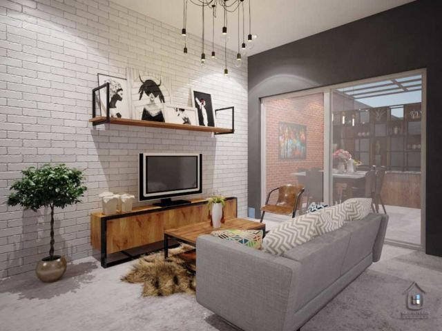 Ruang keluarga yang instagramable menggunakan tanaman indoor di Kemurnian House karya Aru Interior