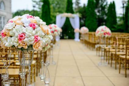 Photo by selective focus photography white and pink isle flower arrangement