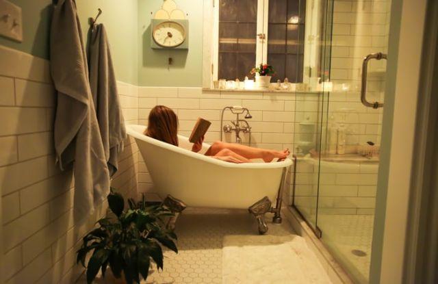 Person in white ceramic bathtub by Ava Sol