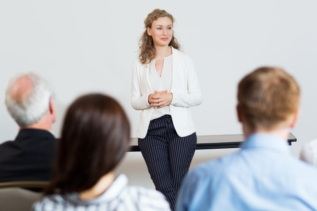 Woman Giving a Lecture to Audience