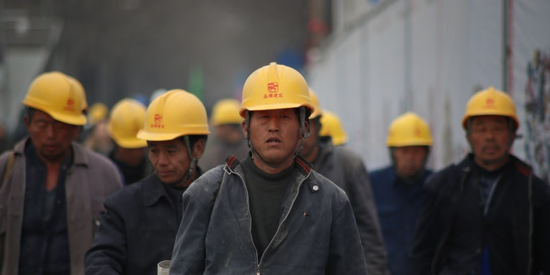 Grup of Person Wearing Yellow Safety Helmet During Daytime