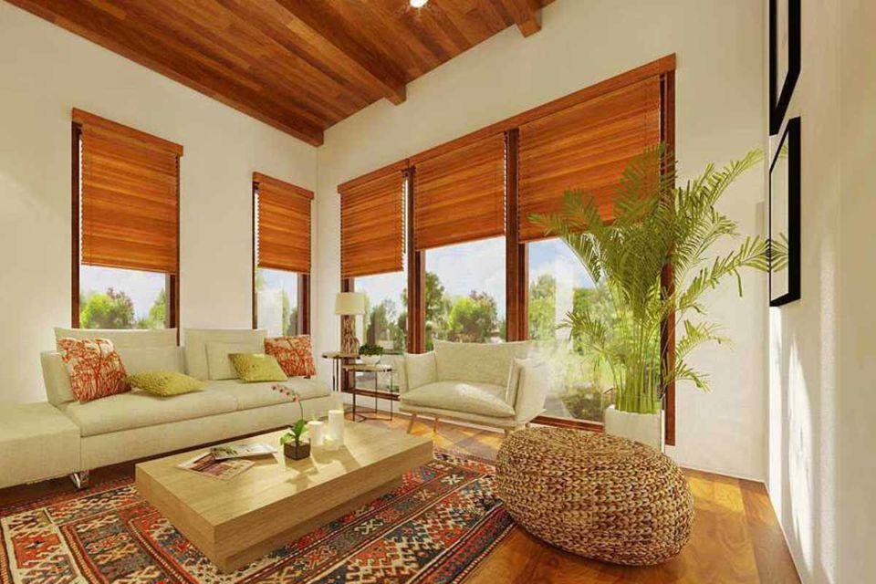 Interior rumah tropis dengan tanaman hijau karya Lumos Interior Design