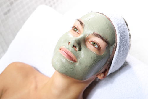 Women using clay mask