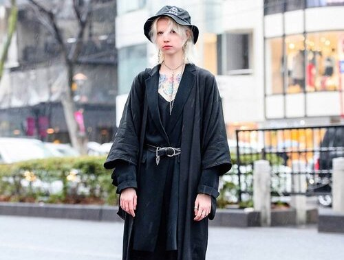 Lotus Agency Model's Chic All Black Tokyo Style w/ Chest Tattoos, Bucket Hat, Silver Chain Accessories, Kimono Coat, V-Neck Top, Pink Panther, Statement Tote Bag & Heeled Boots