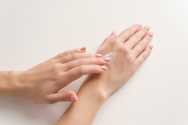 Women using hand cream
