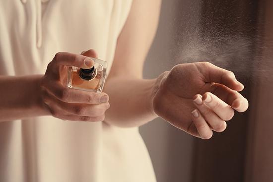 Women using perfume